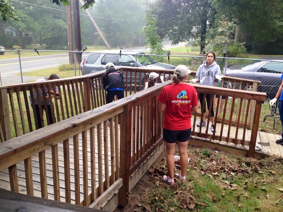 Volunteers working on wheelchair ramp