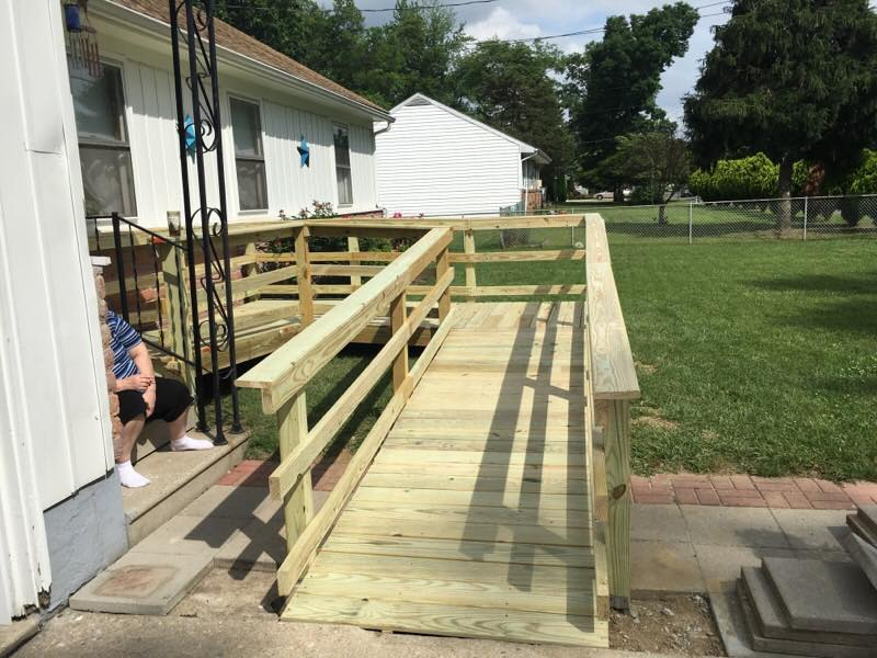 Wheel chair ramp with fresh weather resistant lumber