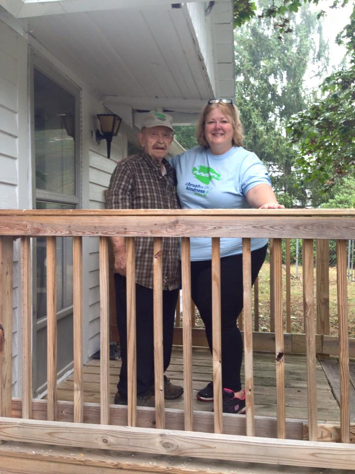 Man and woman standing on porch