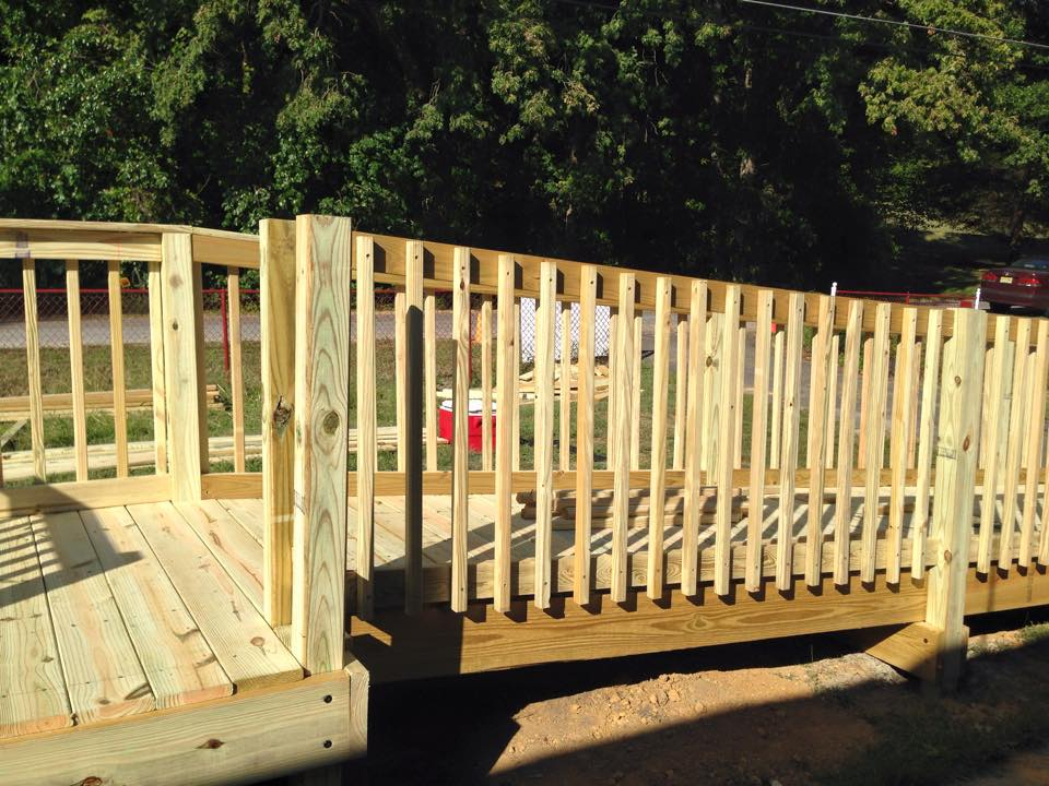 Freshly constructed wheelchair ramp before the wood has been stained