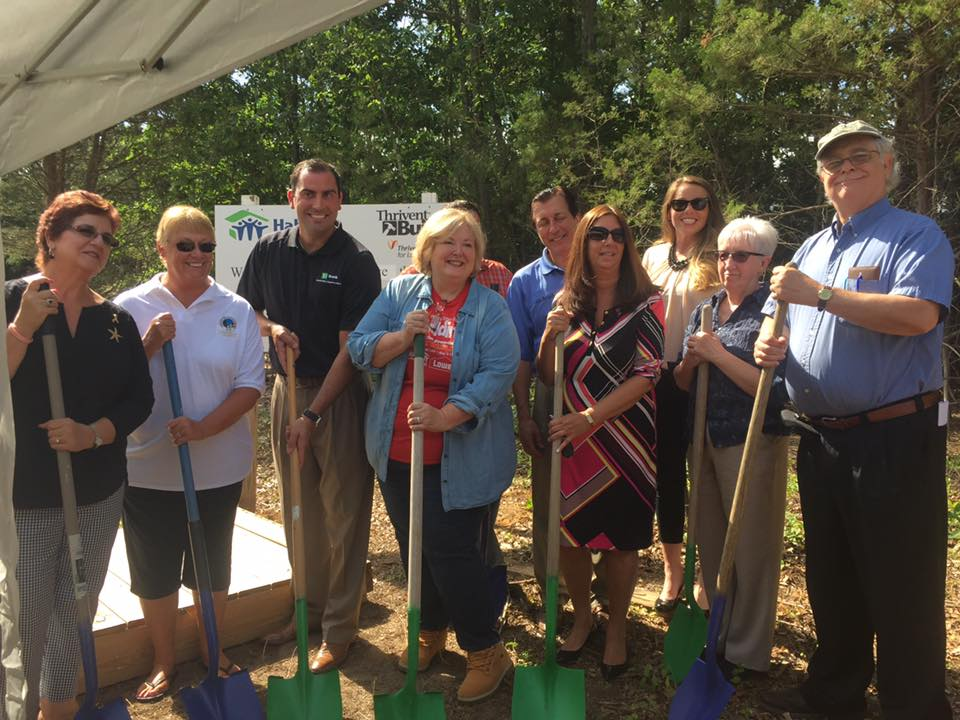 Group holding shovels for a ground breaking ceremony
