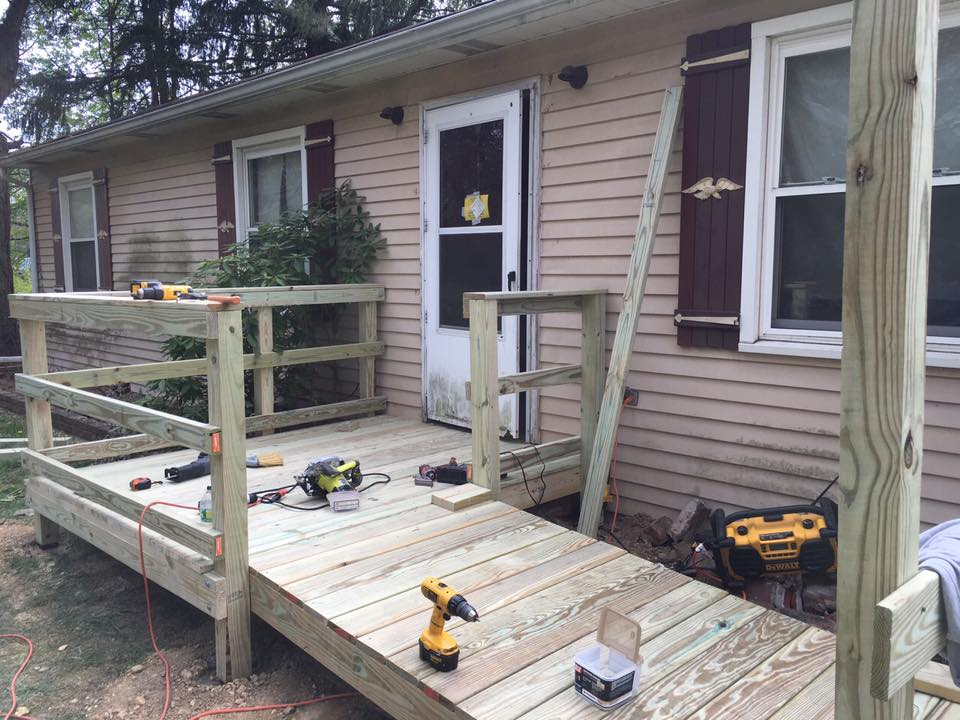 Wheelchair ramp in progress with tools sitting on it