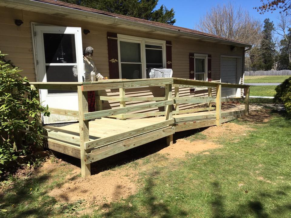 Newly made wheelchair ramp along rancher style house