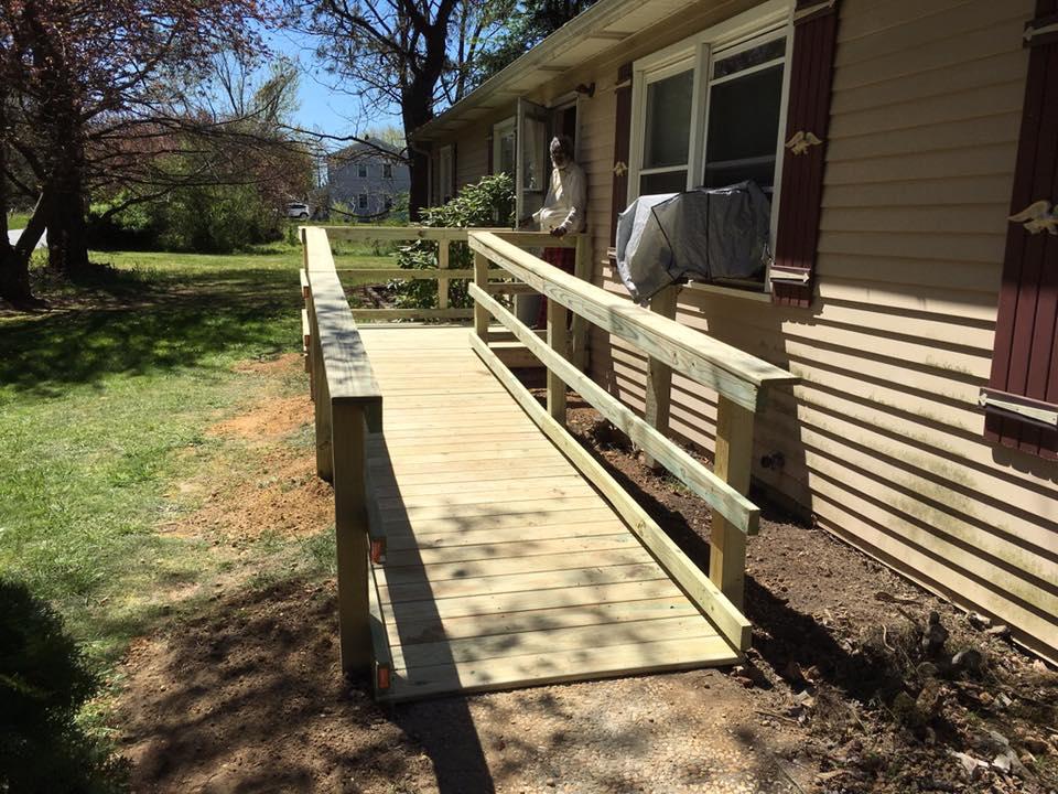 New wheelchair ramp and person standing in front door