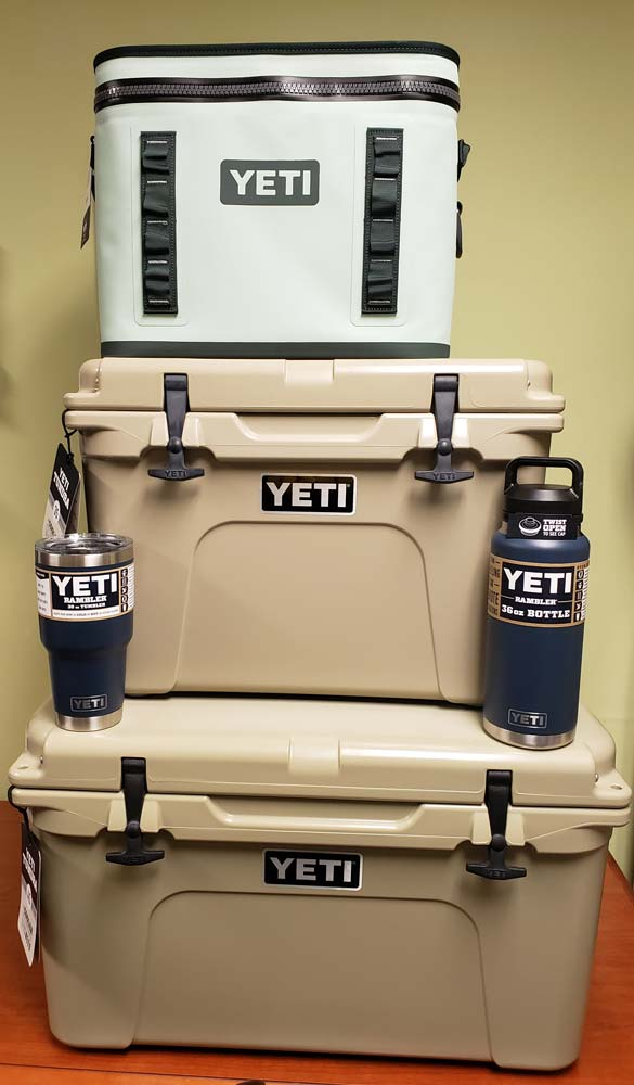Three YETI coolers stacked on each other